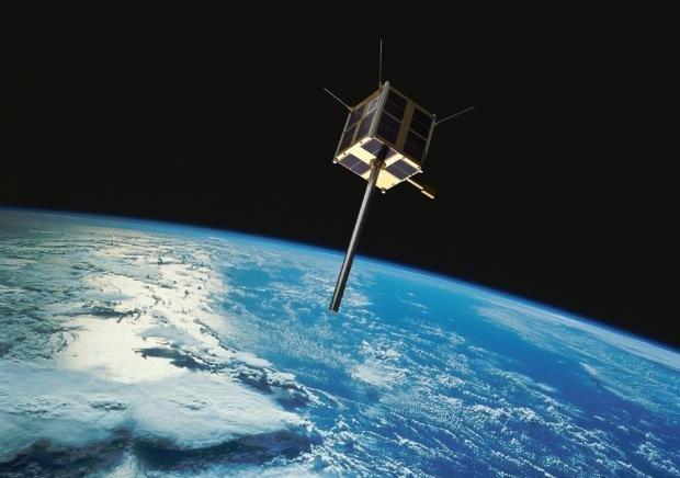 Illustrasjon av AISSat-1 i bane